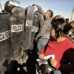 Sociedad civil en evento de la OCDE en México rechaza la represión en Oaxaca
