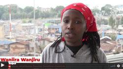 wanjira wanjiru talking to camera with a town in the background