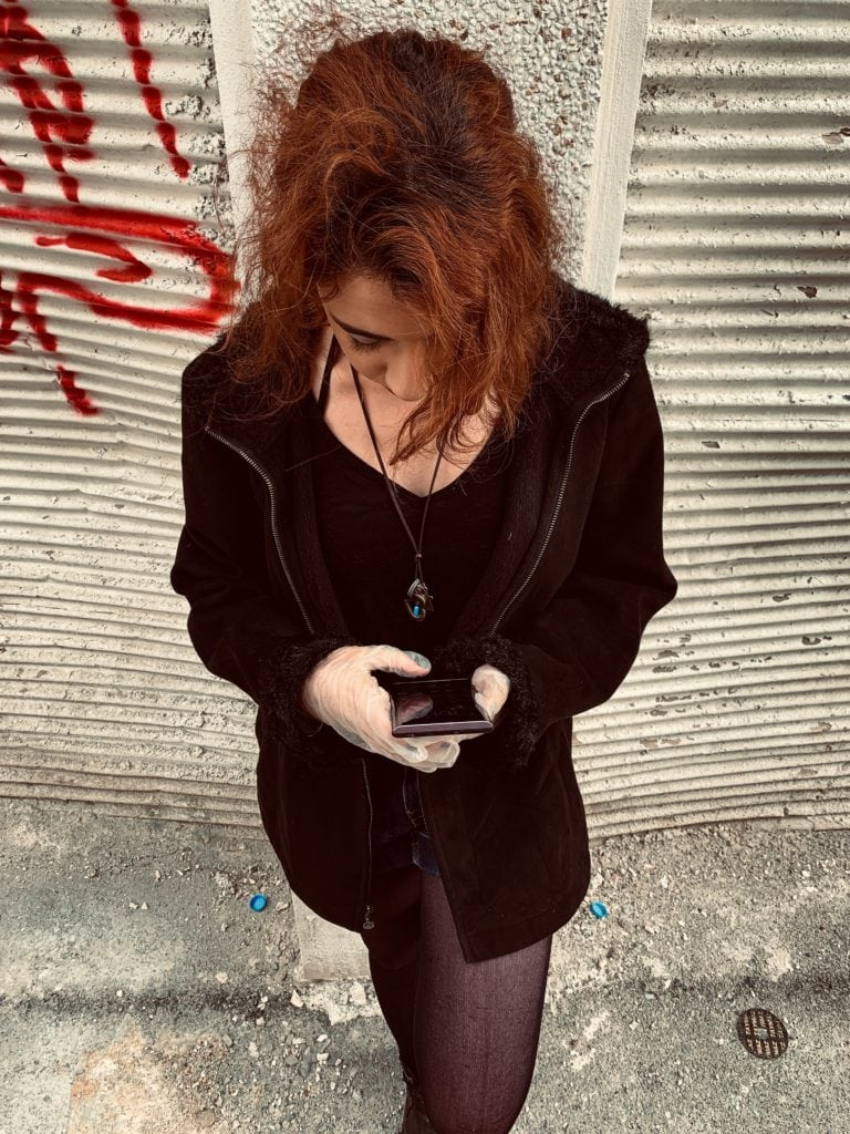 Iranian woman looking at phone