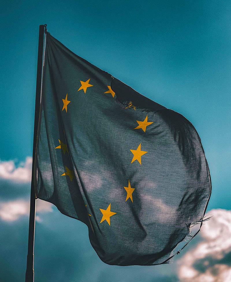 european union flag with a blue sky behind