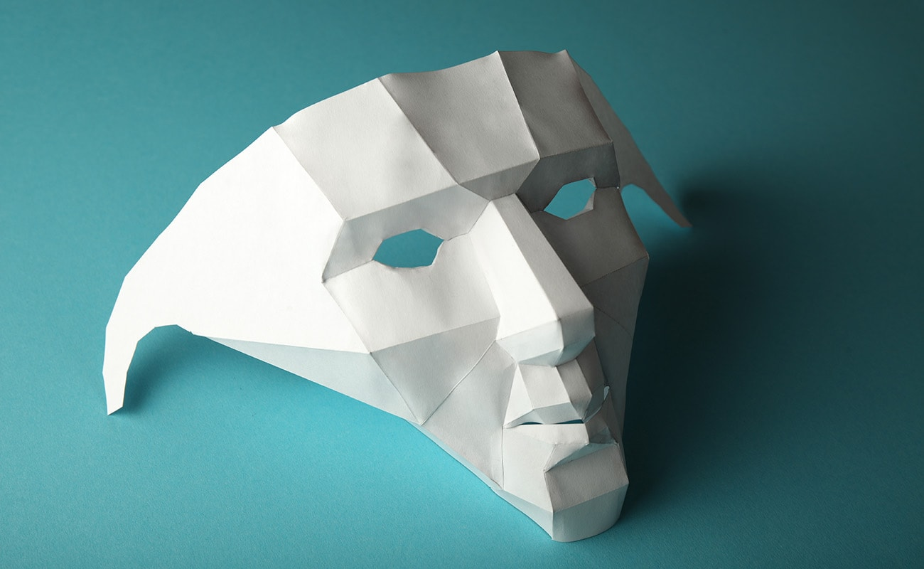 A paper mask on a blue background