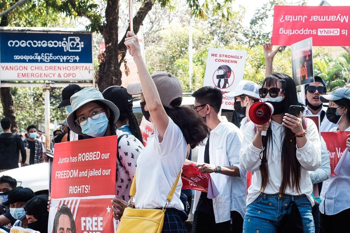 Protestors in Myanmar with megaphones