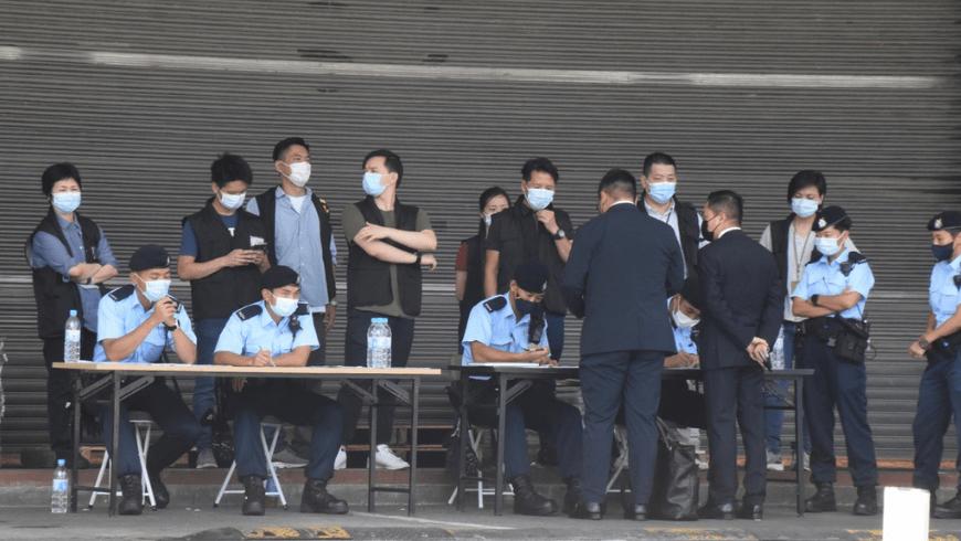 Hong Kong police during Apple Daily raid